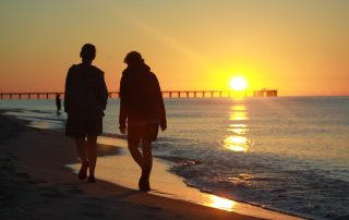 couple walking together at sunset